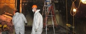 Water Damage Restoration Technician Working In Basement