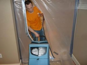 Water Damage Enfield Technician Using Air Mover Near Vapor Barrier