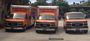 Water and Mold Damage Restoration Van And Trucks At Job Location